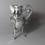 pot à lait en métal argenté de style empire vers 1900. hauteur 13 cm. 35€